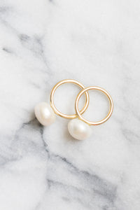 pearl lollipop 14k gold rings on marble janna conner