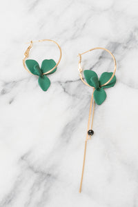 green flower mismatched hoop earrings