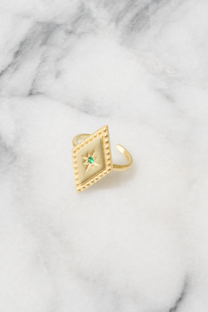 gold diamond shaped stacking ring with green cubic zirconia center