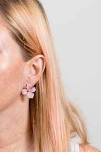pink flower stud earrings on model