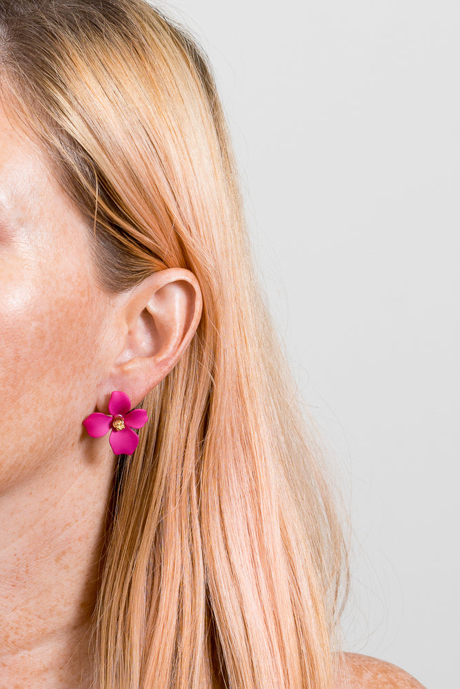 hot pink flower earrings on model