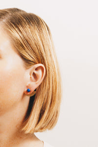 blue ear jacket earrings on model
