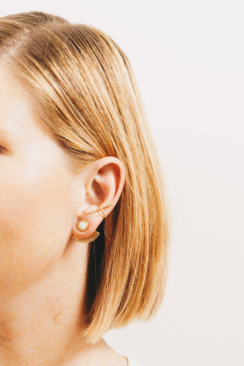 gold ear cuff with bar on model