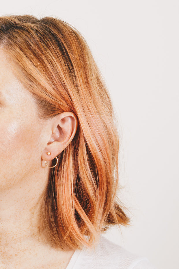 Janna Conner Solene gold hoop ear jacket earrings on model with strawberry blonde hair