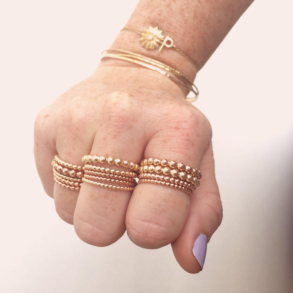 gold bubble stacking rings on model