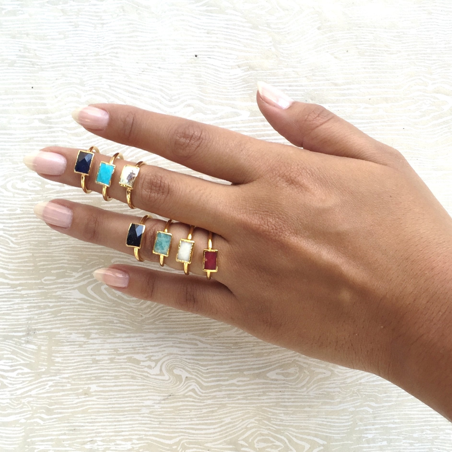 semi-precious stone stacking rings on hand