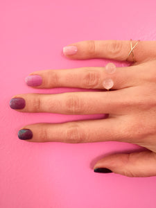 ombre glitter nails on model with rose quartz thibaut ring by janna Conner with pink wall