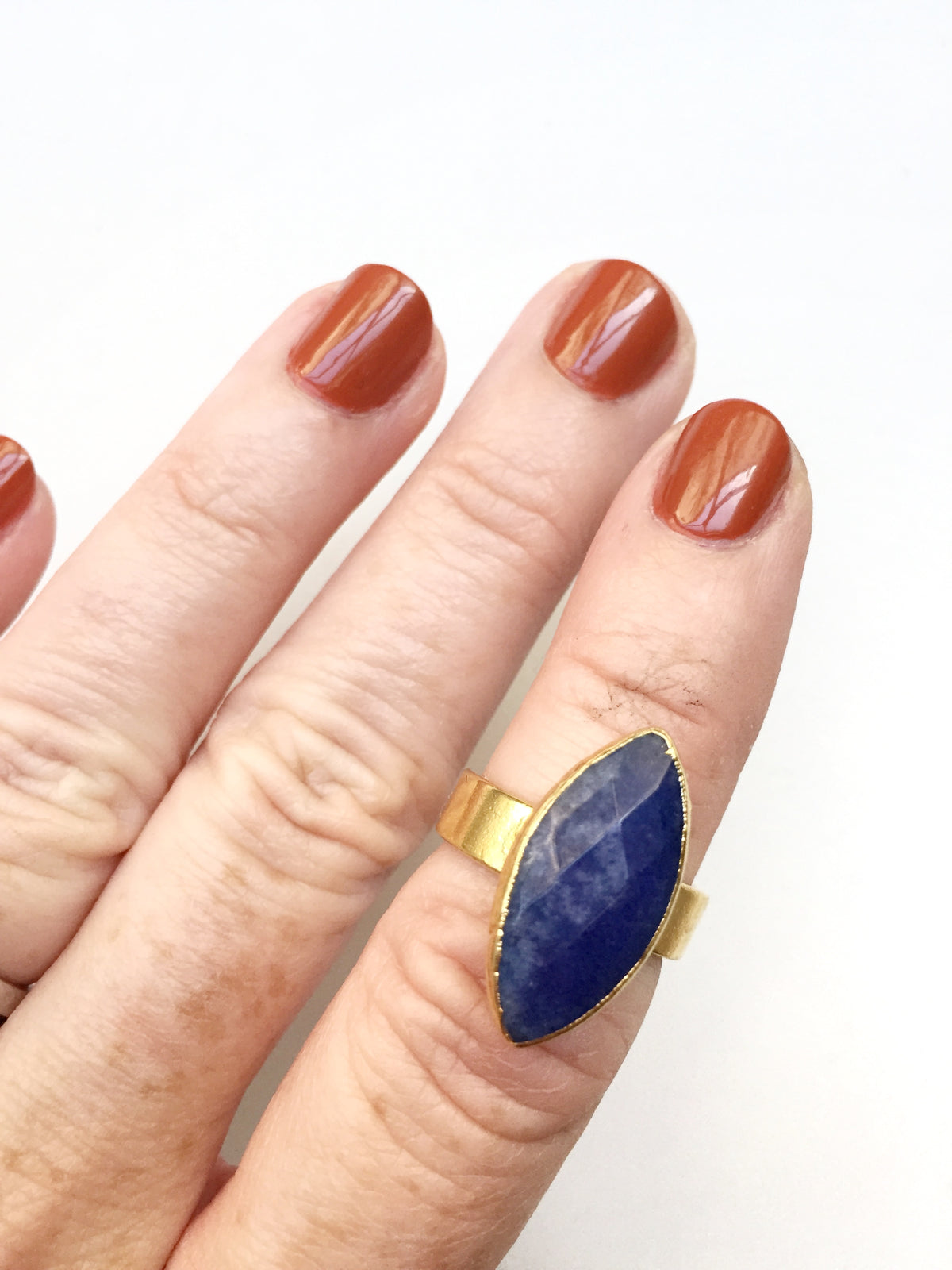 blue jade marquis ring on hand