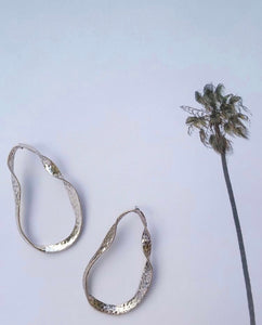 silver twisted metal earrings with palm tree picture