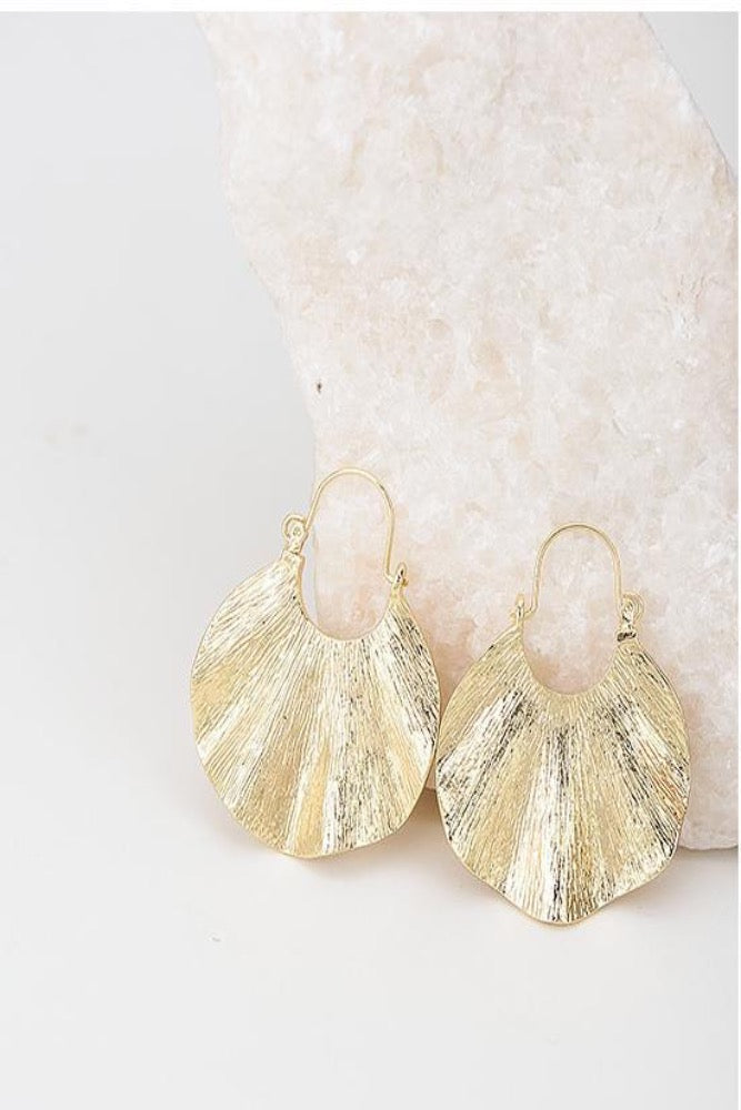 gold boho hoop earrings on stone