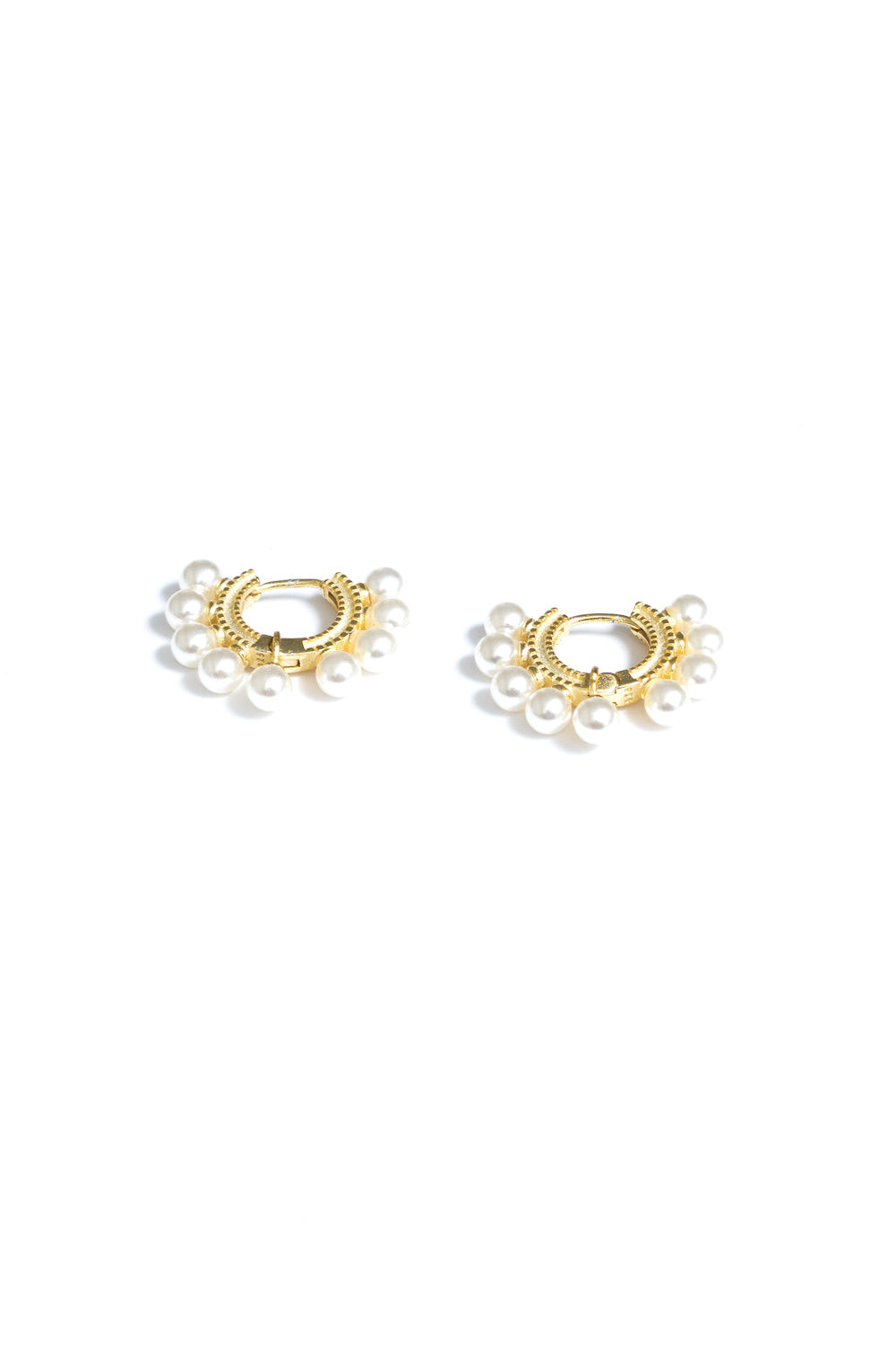 pearl mini gold hoop huggie hoop earrings by janna conner
