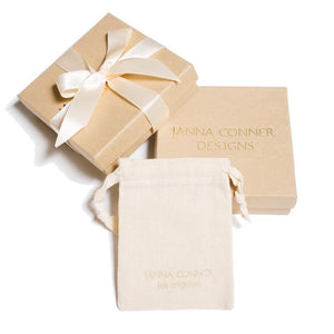 Janna Conner branded jewelry pouch and box packaging