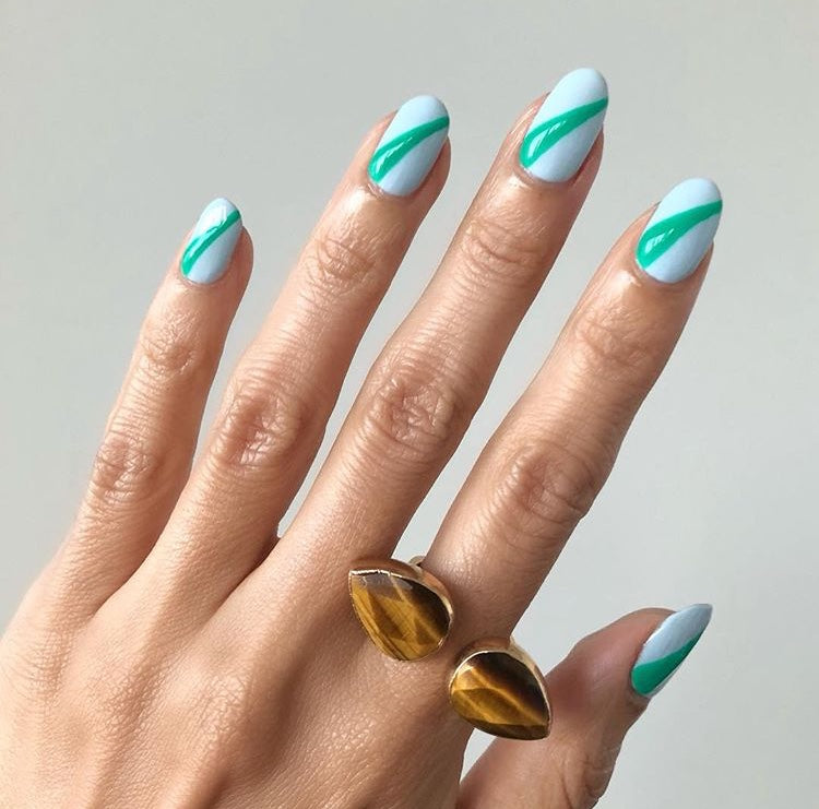 tiger eye open ring on hand with blue nail art