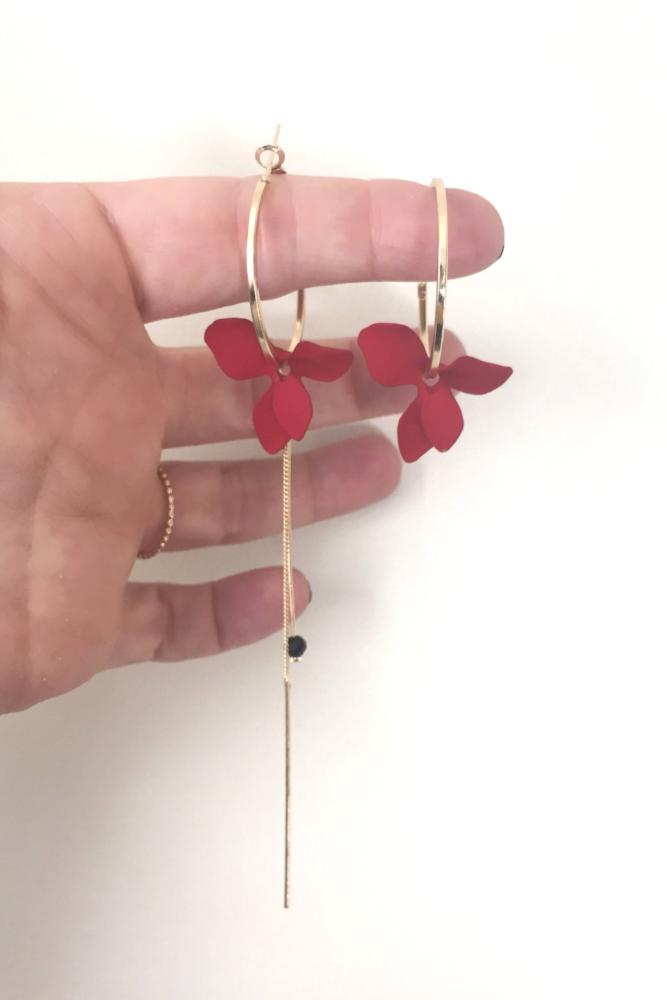 red flower hoop earrings on hand