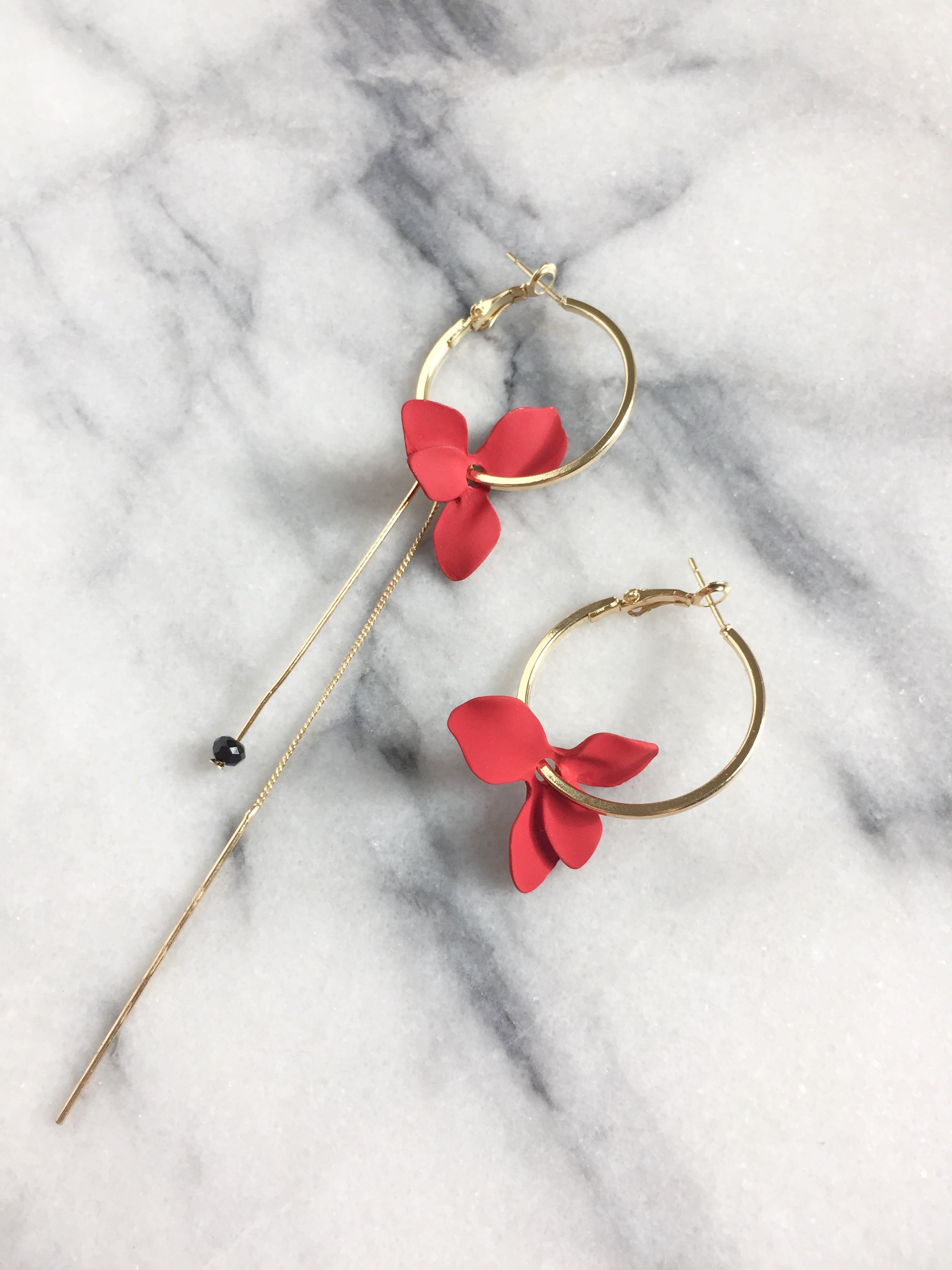 red flower mismatched hoop earrings side view
