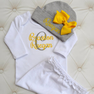 Braxton Raegan monogrammed baby outfit with yellow and gray accents with yellow bow on hat