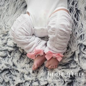 White scrunch leggings with pink bows on baby girl