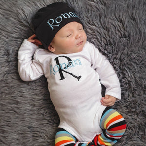 Ronan white black and blue romper with colorful striped leggings