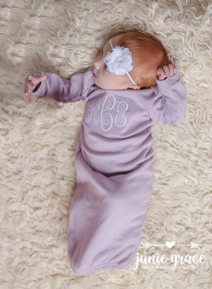 baby girl wearing a lavender one piece romper with name monogrammed on it