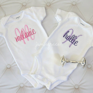 Melanie and Hallie baby girl twin matching rompers