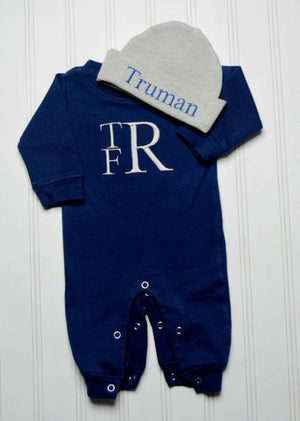 Baby boy Truman wearing his monogrammed and personalized navy blue and grey matching romper and hat set