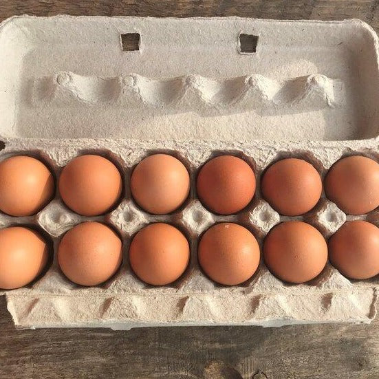 Carton of a dozen eggs.