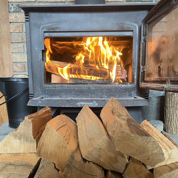 pile of firewood in front of wood stove