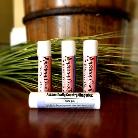 Cherry Mint Lip Balm | Photo has 4 tubes of chapstick with stunning red, white, and blue label