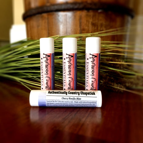 Cherry Vanilla Mint Lip Balm | Photo has 4 tubes of chapstick with stunning red, white, and blue label