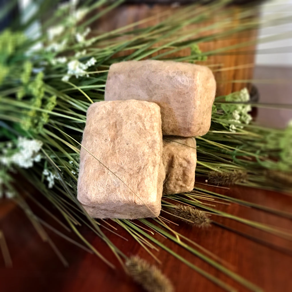 4 oz. bar of goat milk soap wrapped in luxurious raw alpaca fiber
