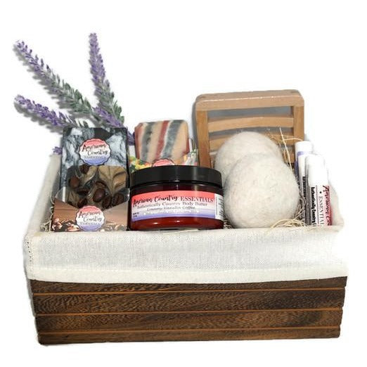 Beautiful wooden gift basket full of the following products: 2 goat milk soaps, 1 goat milk face soap, 1 4 oz. goat milk lotion, 1 wooden soap dish, 2 alpaca balls, 4 all natural chapsticks.