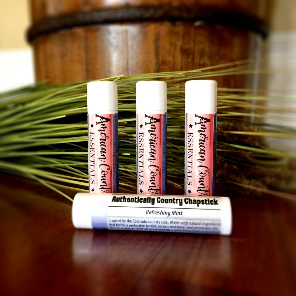 Refreshing Mint Lip Balm | Photo has 4 tubes of chapstick with a stunning red, white, and blue label.