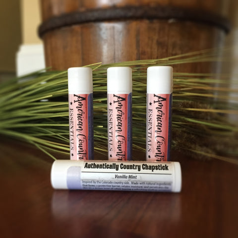 Vanilla Mint Lip Balm | Photo has 4 tubes of chapstick with stunning red, white, and blue label