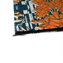 Zip closure on designer pouch in tropical face print