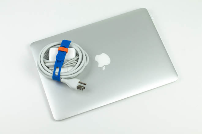 Reusable silicone Packbands hold extension and charger cords and cables in the office, home office, garage and workshop