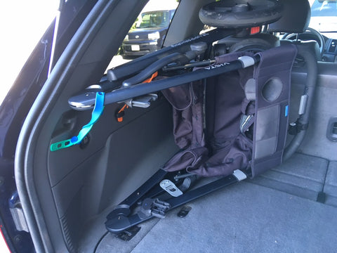 Packbands securing a stroller in a car trunk or SUV