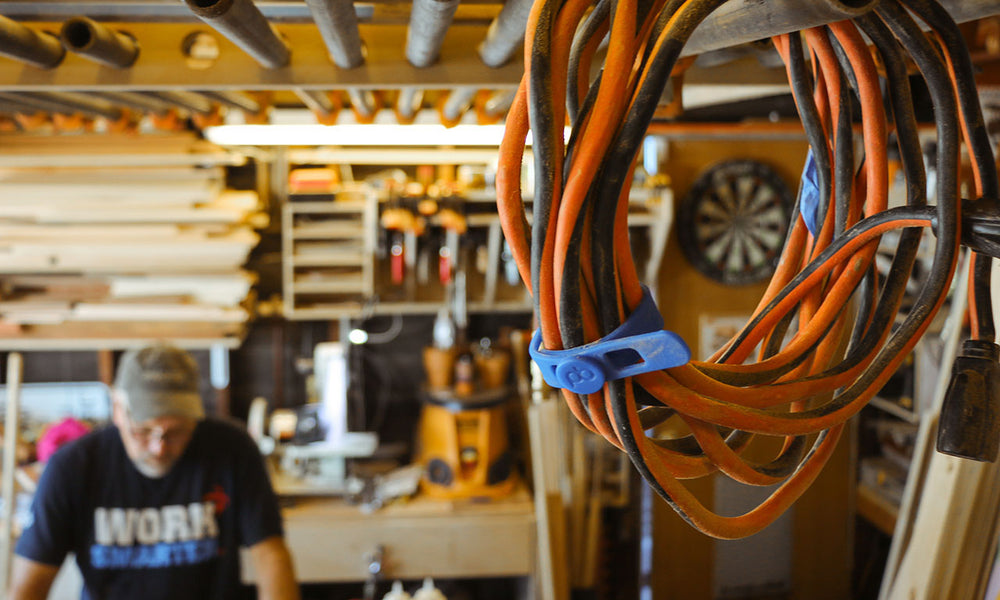 Man working in garage workshop Packbands are holding extension cords