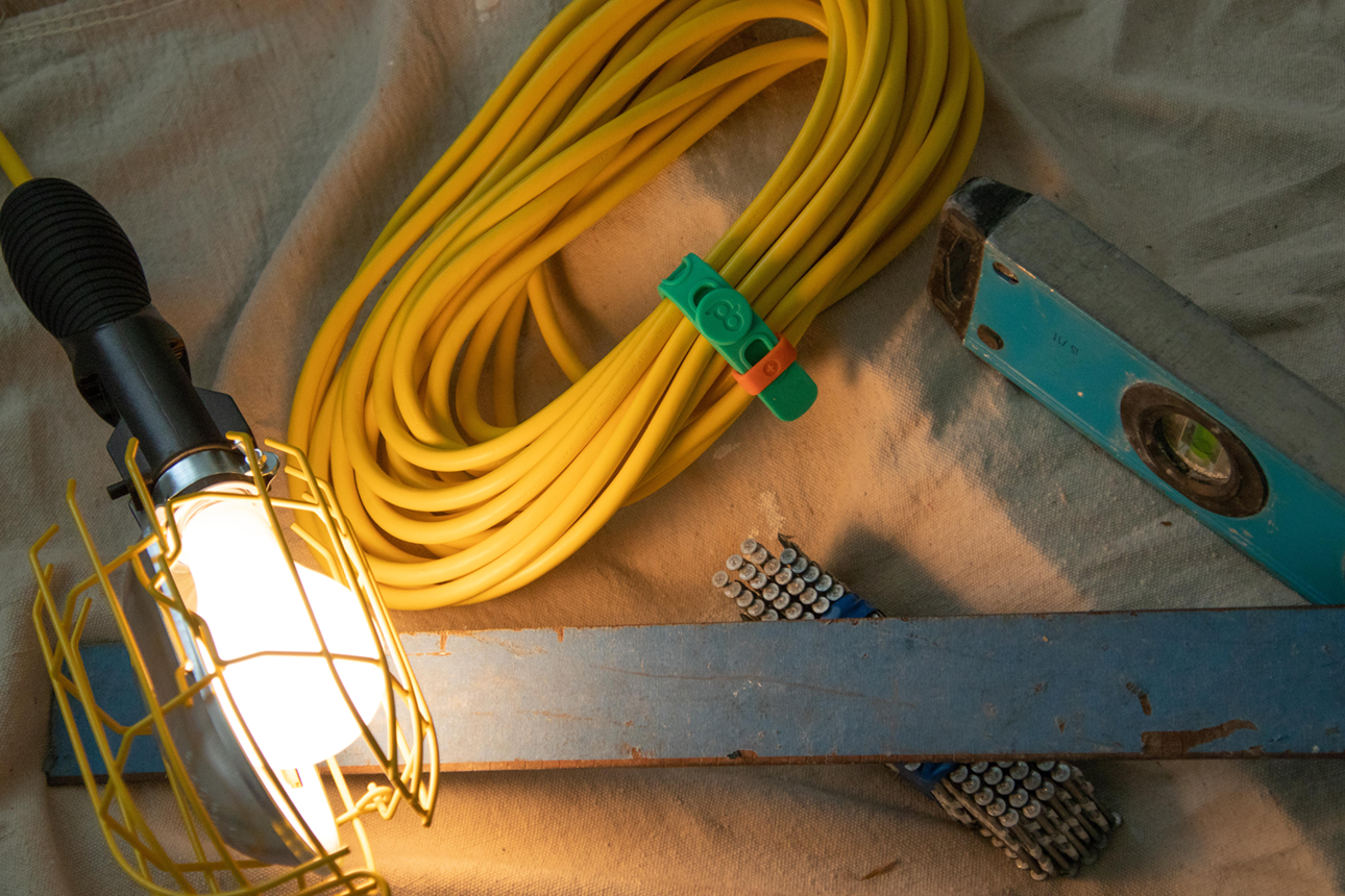Construction equipment and power tool cord organized with a Packband