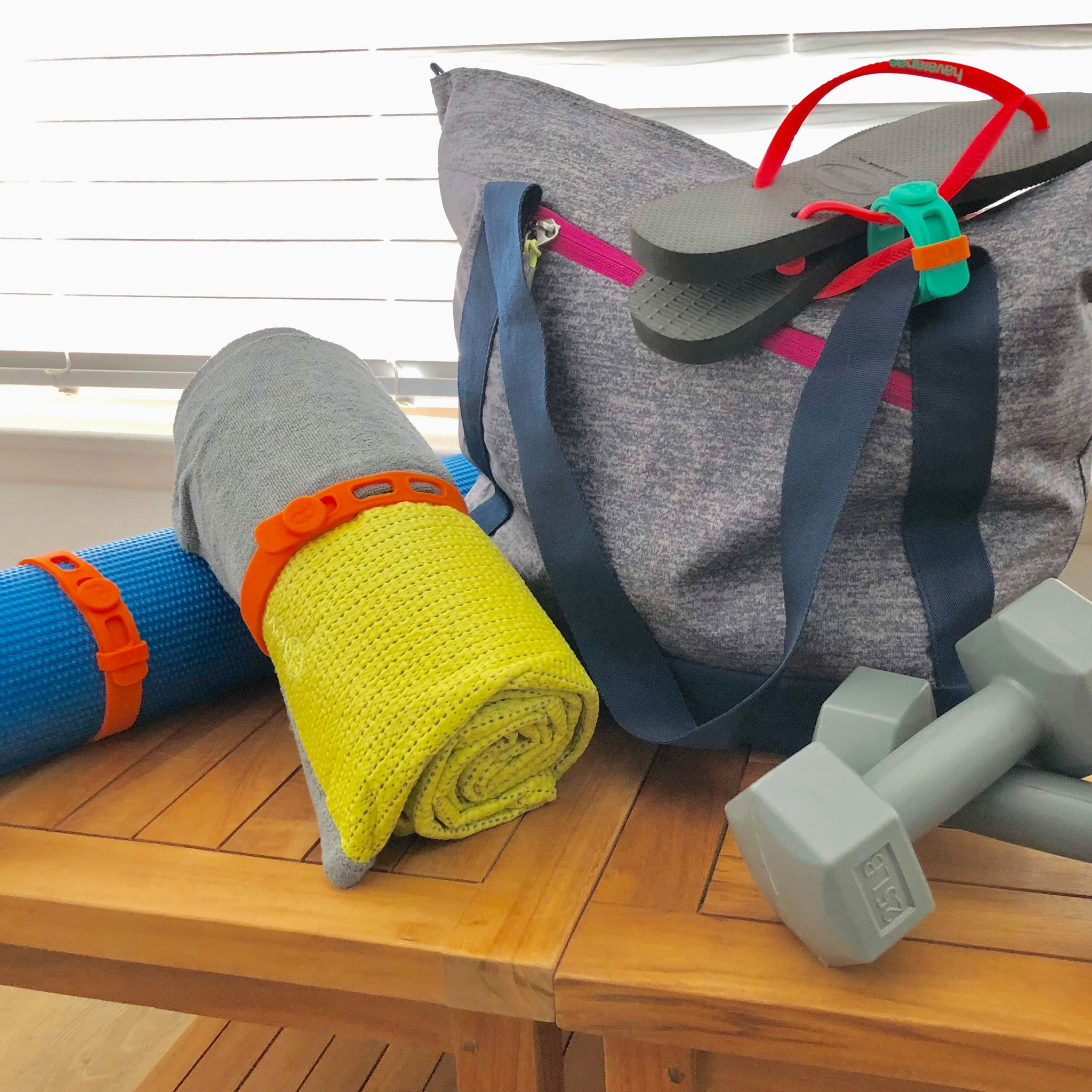 Packbands can be used at the gym as a yoga mat holder, as a band for yoga towels and to attach shower thongs and gear to workout bag.