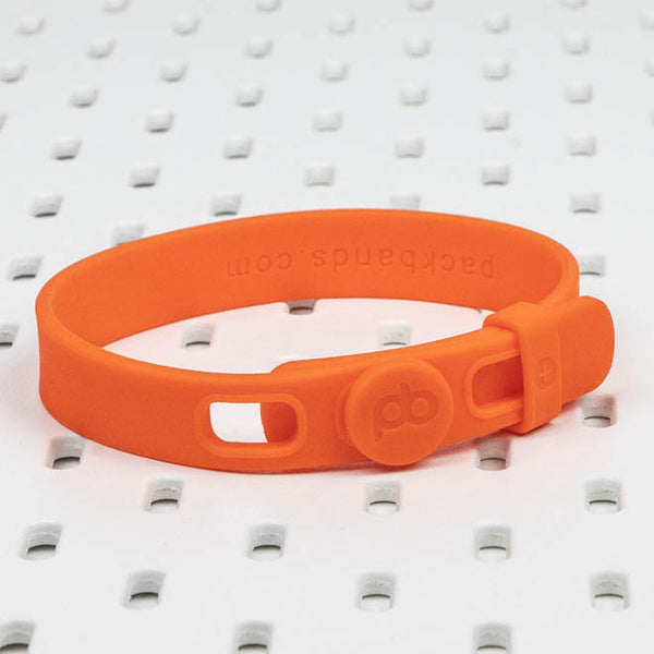 The large orange Packband is available as a Packbands SinglePack and can be a yoga mat holder, organize extension cords and computer cables or store bulky clothing or linens