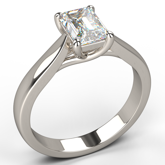 traditional four claw emerald cut diamond engagement ring