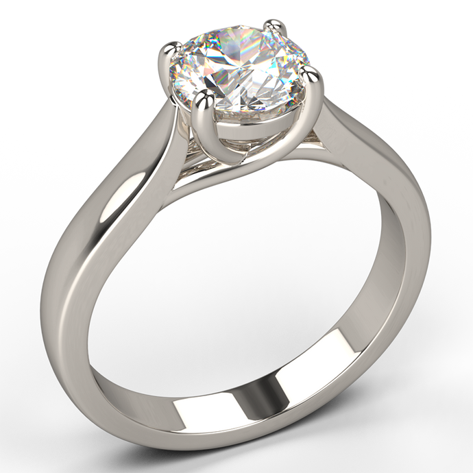 traditional four claw solitaire diamond engagement ring