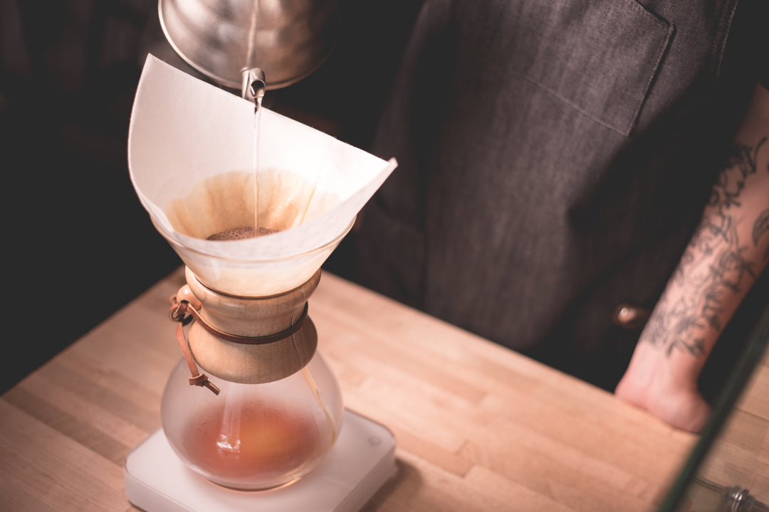 Coffee being precision brewed using the chemex pour over method