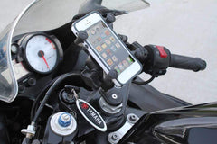 close-up-of-motorcycle-with-smartphone-mounted-behind-windscreen