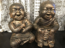 Baby laughing Monks