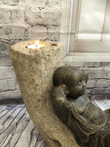 Monk on a Trunk Candle Holder