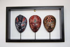 Painted Masks in Wooden Frame