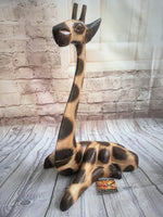 Hand carved Laying Giraffe Statue