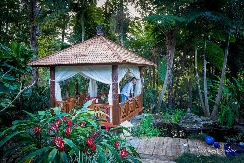 Shingle roof bali hut with light shades provide a serene feel