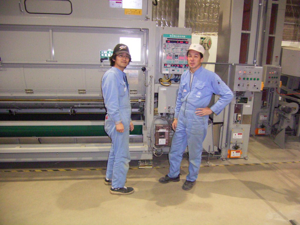 engineers with newly installed machinery